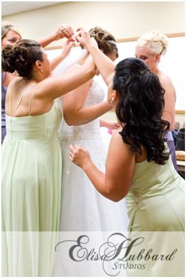 Getting Ready - Bridesmaids helping put the veil on - Helping Hands - Wedding Photography - Elisa Hubbard Studios